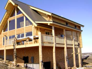 Log Home Construction on Full Size Custom Basement