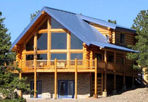 Sundown log home with big logs and shed dormer roof
