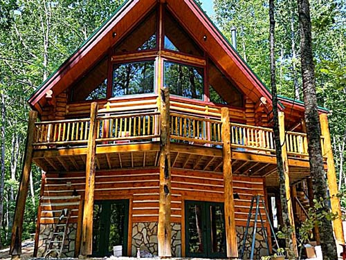 sundown front view of beautiful log home packag