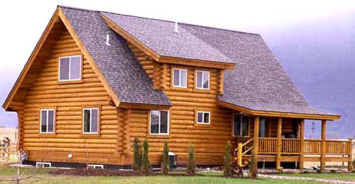 back view of log cabin with a roof dormer