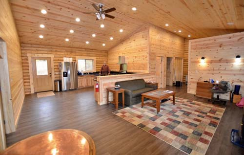 Eagle Creek log cabin open floorplan cathedral ceiling