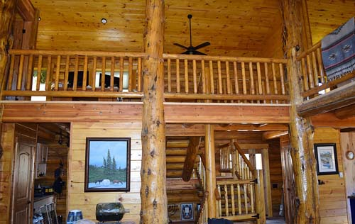 Inside of an Lewis and Clark Lodge log home living area 500