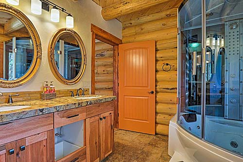 log cabin master bath with steam show double vanity