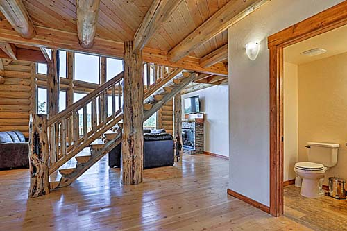 Ponderosa entry foyer and log character from Lazarus Utah