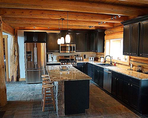 Spruce kitchen with rock and granite for a log home