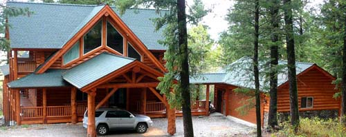 Yellowstone chalet from Lazarus Log Homes breezeway to garage wyoming