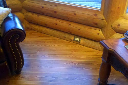 fir flooring and electrical outlet in a log home plan