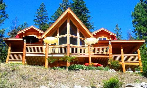 hybrid 3d prow log design front overlooking lake vrbo in canada