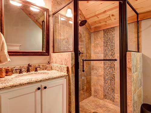 log cabin bathroom in the loft colorado tile and glass shower