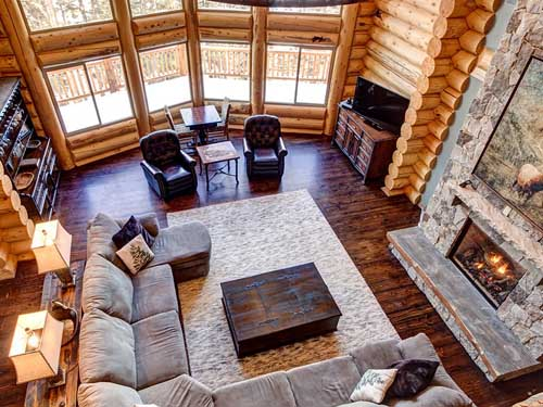 looking down on a log cabin package living room Utah builder