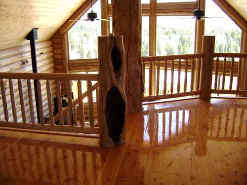 sundown loft 58ths with flooring and railing character logs