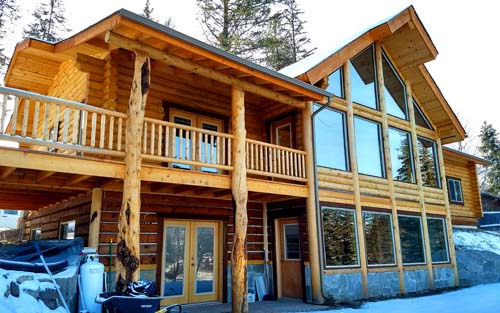 Highlander Ridge log cabin on basement rock and timber siding whitefish river property
