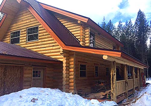 Log cabin design full length porches shed dormers garage Whitefish montana
