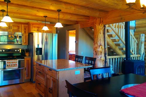 Pinnacle Sunup chalet 34 loft kitchen log cabin to entry view 500
