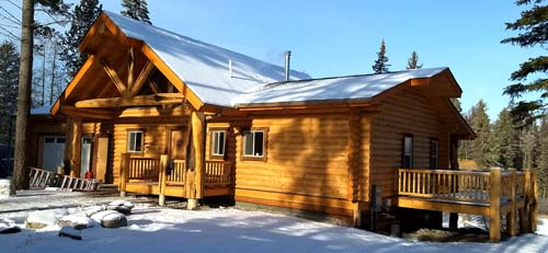 Ranch style log home design with truss at entry whitefish Columbia falls montana